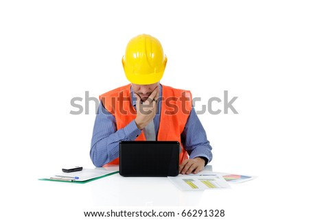 Successful attractive caucasian man architect with safety helmet in the office with laptop and the hand on beard. Studio shot. White background. - stock photo