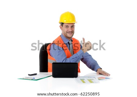Successful attractive caucasian man architect with safety helmet in the office with laptop. Thumb-up. Studio shot. White background. - stock photo