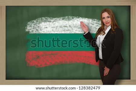Successful, beautiful and confident woman showing flag of bulgaria on blackboard for marketing research, presentation and tourist advertising - stock photo