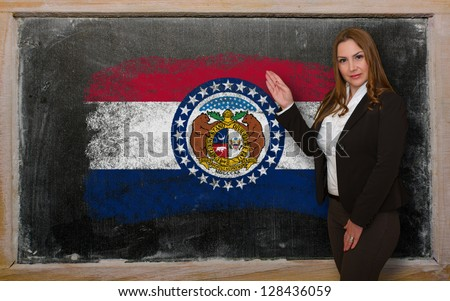 Successful, beautiful and confident woman showing flag of missouri on blackboard for marketing research, presentation and tourist advertising - stock photo
