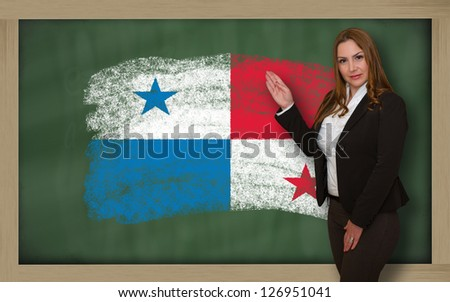 Successful, beautiful and confident woman showing flag of panama on blackboard for marketing research, presentation and tourist advertising - stock photo