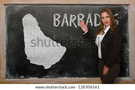Successful, beautiful and confident young woman showing map of barbados on blackboard for presentation, marketing research and tourist advertising