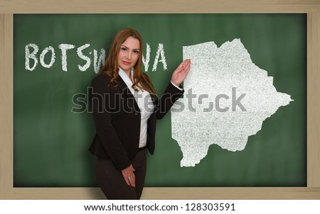 Successful, beautiful and confident young woman showing map of botswana on blackboard for presentation, marketing research and tourist advertising - stock photo