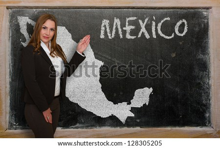 Successful, beautiful and confident young woman showing map of mexico on blackboard for presentation, marketing research and tourist advertising - stock photo