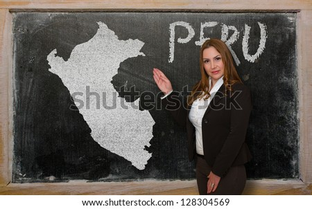 Successful, beautiful and confident young woman showing map of peru on blackboard for presentation, marketing research and tourist advertising - stock photo