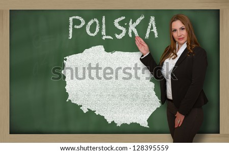 Successful, beautiful and confident young woman showing map of polska on blackboard for presentation, marketing research and tourist advertising - stock photo