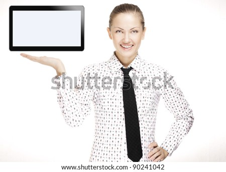 successful beautiful young business woman holding open hand palm with a tablet pc on it , touchpad pc - stock photo