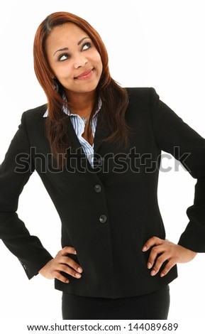 Successful Black Woman Posing With Hands On Hips Looking Away From Camera - stock photo