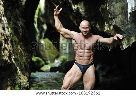 Successful bodybuilder posing - stock photo