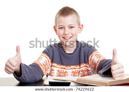 Successful boy in school holding both thumbs up - stock photo