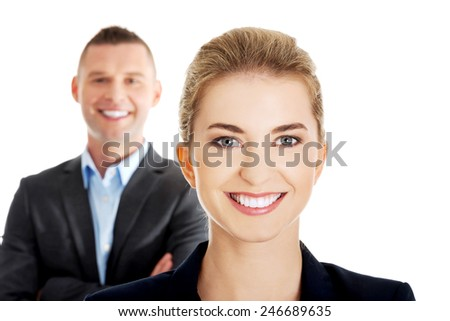 Successful business couple is standing - stock photo