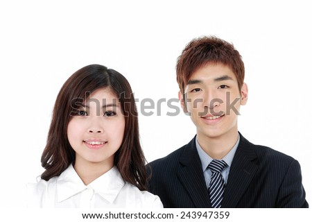 Successful business couple is standing on isolated background - stock photo