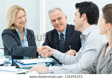 Successful Business Executives Shaking Hands With Each Other - stock photo