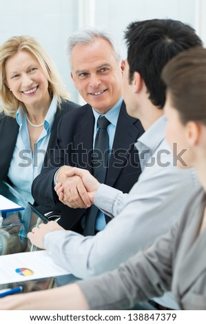 Successful Business Executives Shaking Hands With Each Other