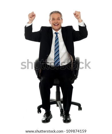Successful business gesturing happiness, seated on chair. All on white background - stock photo