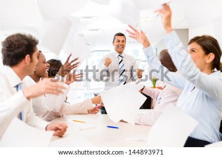 Successful business group  celebrating at the office - stock photo