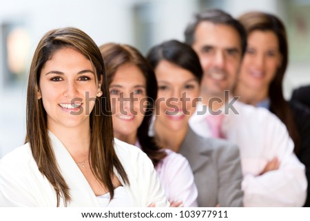 Successful business group in a row smiling