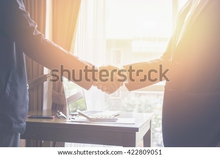 Successful business,Handshake,Business man holding hands closeup,selective focus,Vintage tone,copy spa - stock photo