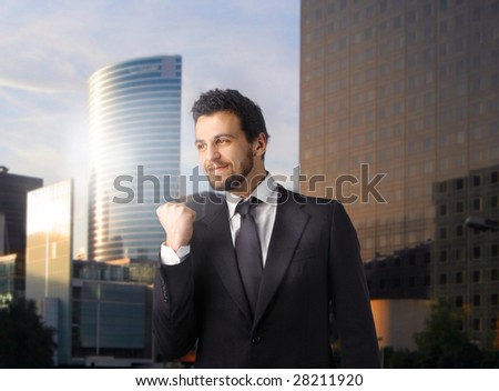 Successful business man against a urban background - stock photo