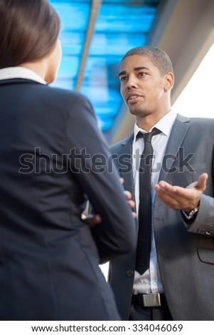 successful business man and woman outdoors - stock photo