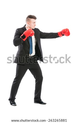 Successful business man fighting like a boxer wearing red boxing gloves - stock photo