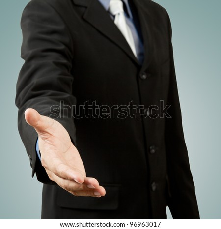 successful business man, gesturing handshake or help - stock photo