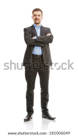 Successful business man in suit is posing in studio isolated over white background. Full body portraits. - stock photo