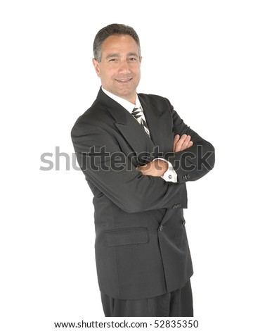 Successful business man in suit with arms folded