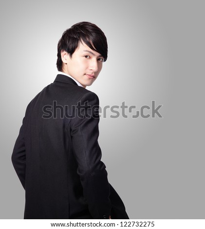 Successful business man smiling face and looking to you with gray background, model is a asian male - stock photo