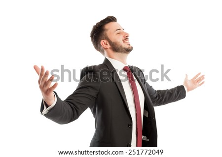 Successful business man spreading arms - stock photo