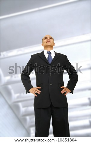 successful business man standing outdoor in front of  contemporary business building