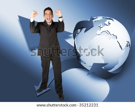 Successful business man with a globe behind him - stock photo