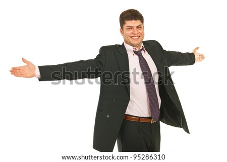 Successful business man with arms outstretched isolated on white background