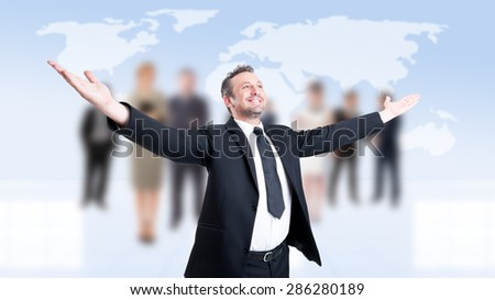 Successful business man with arms outstretched or outspread with business people background - stock photo