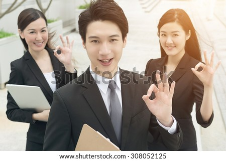 Successful business man with his young team partner in Hong Kong. - stock photo