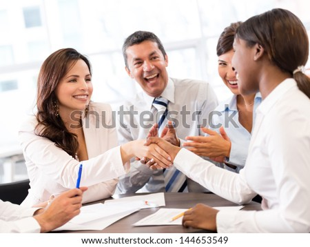 Successful business meeting ending with a handshake - stock photo