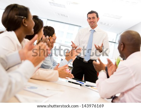 Successful business meeting with a group of people at the office - stock photo