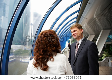 Successful business partners at a meeting at a window overlooking the trade center - stock photo
