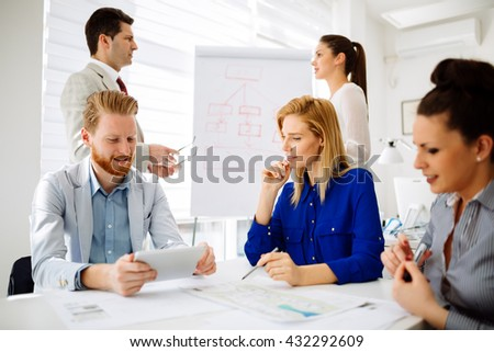 Successful business partners brainstorming in office