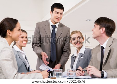 Successful business partners looking at each other during discussion of new plan - stock photo