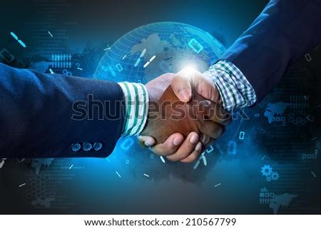 Successful business people handshaking - stock photo