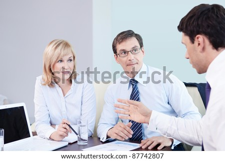 Successful business people in office - stock photo