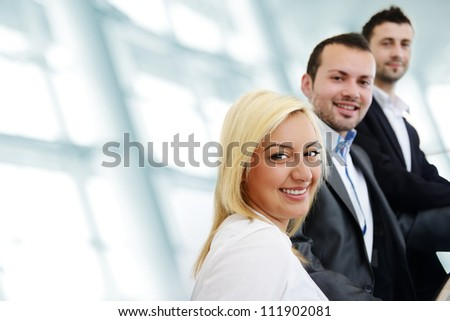 Successful business people indoor with copy space - stock photo