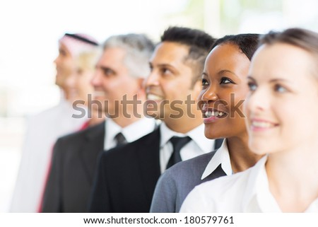 successful business people looking up - stock photo
