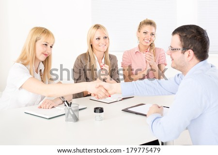 Successful business people shaking hands at the meeting because of Successful Agreement. - stock photo