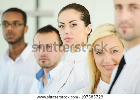 Successful business people standing in row - stock photo