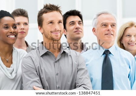 Successful Business People Standing Together and Looking at Their Bright Future - stock photo
