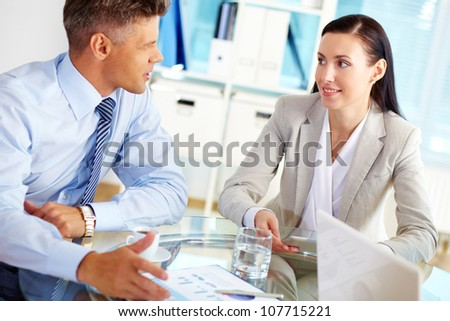 Successful business people talking about the terms of their business relationship - stock photo