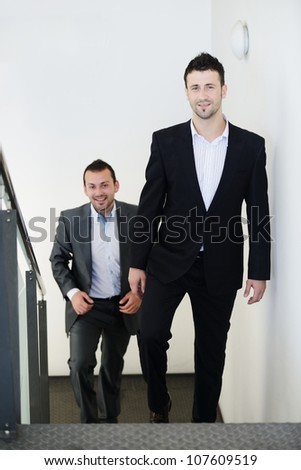 Successful business people walking up stairs