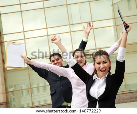 Successful business people with arms up and screaming - stock photo